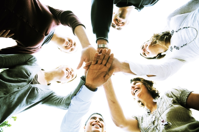 """""""A group of people with hands joined"""", by DG EMPL, Flicker"""
